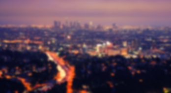 This is a photo of the Los Anglese night skyline, slightly blurred.